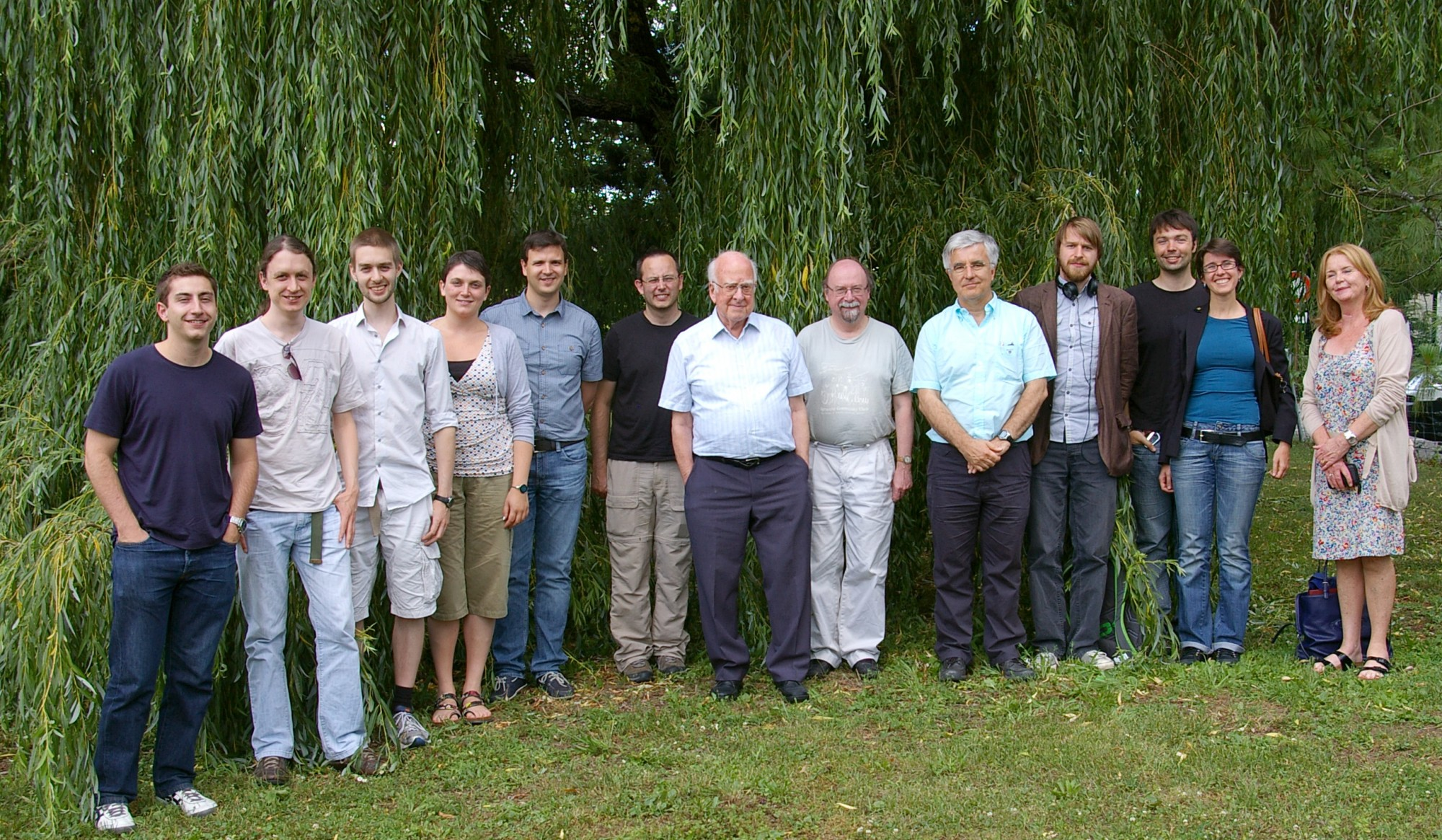Peter Higgs and PhD student Chiara Debenedetti (4th from left) with other members of the ATLAS team.