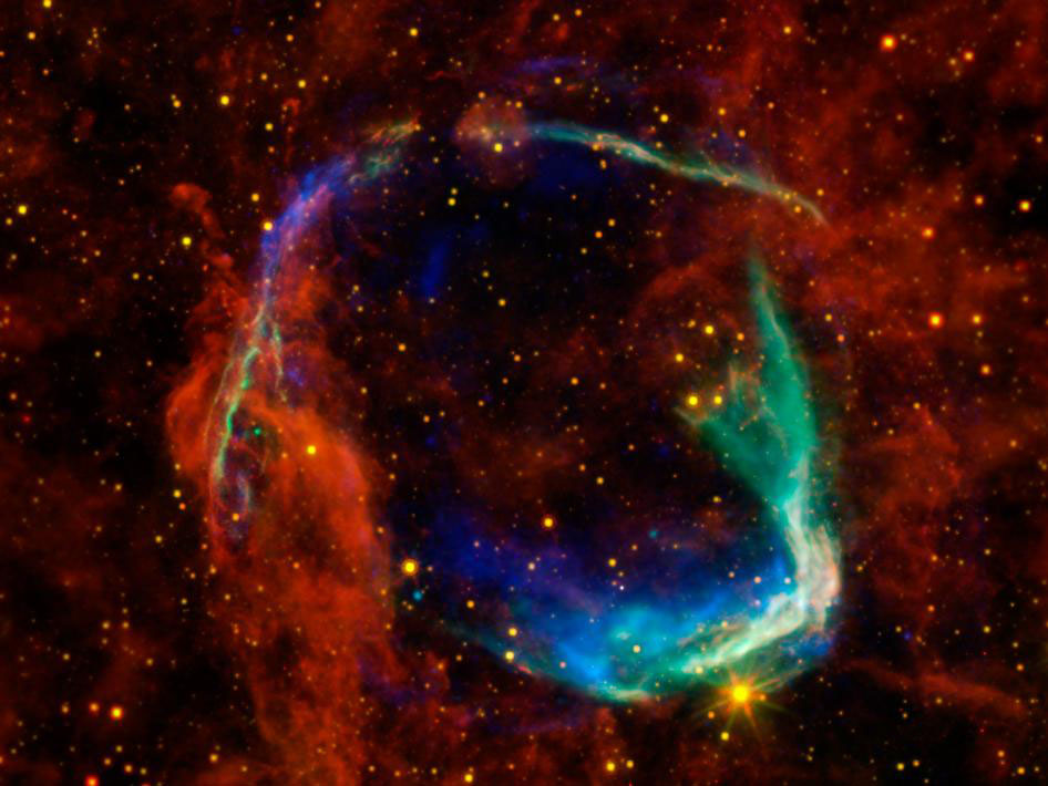 """This image combines data from four different space telescopes to create a multi-wavelength view of all that remains of the oldest documented example of a supernova, called RCW 86. The Chinese witnessed the event in 185 A.D., documenting a mysterious """"guest star"""" that remained in the sky for eight months. Image credit: NASA/ESA/JPL-Caltech/UCLA/CXC/SAO"""
