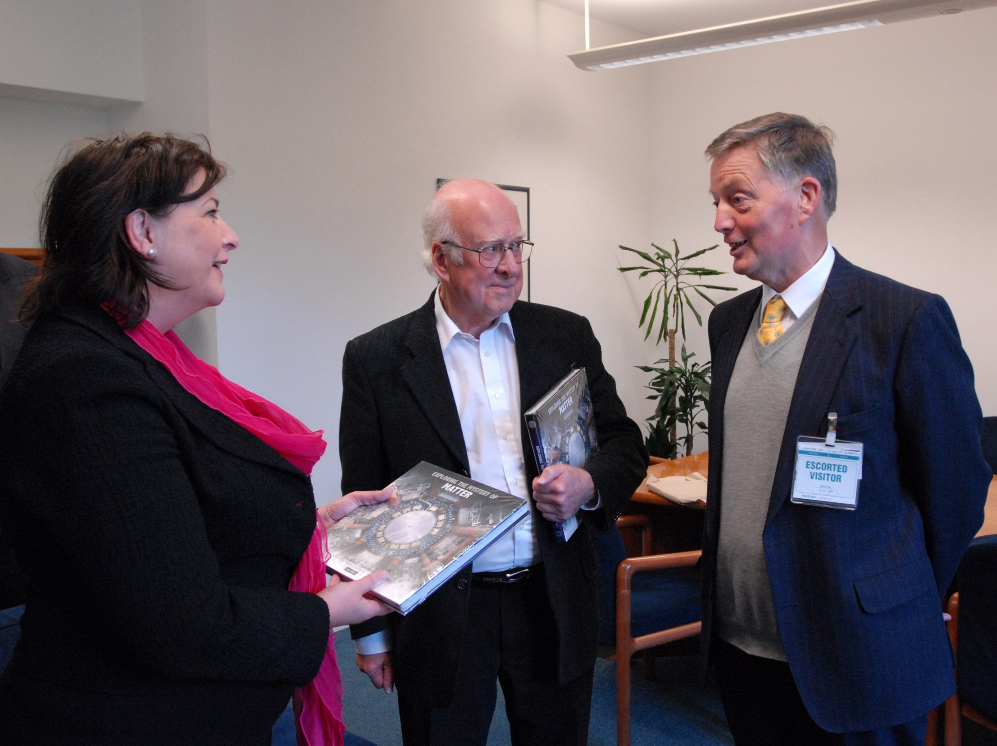 From left to right: Fiona Hyslop, Peter Higgs and Ken Smith. Ken Smith has just presented copies of 'Exploring the Mystery of Matter' to Peter and Fiona.