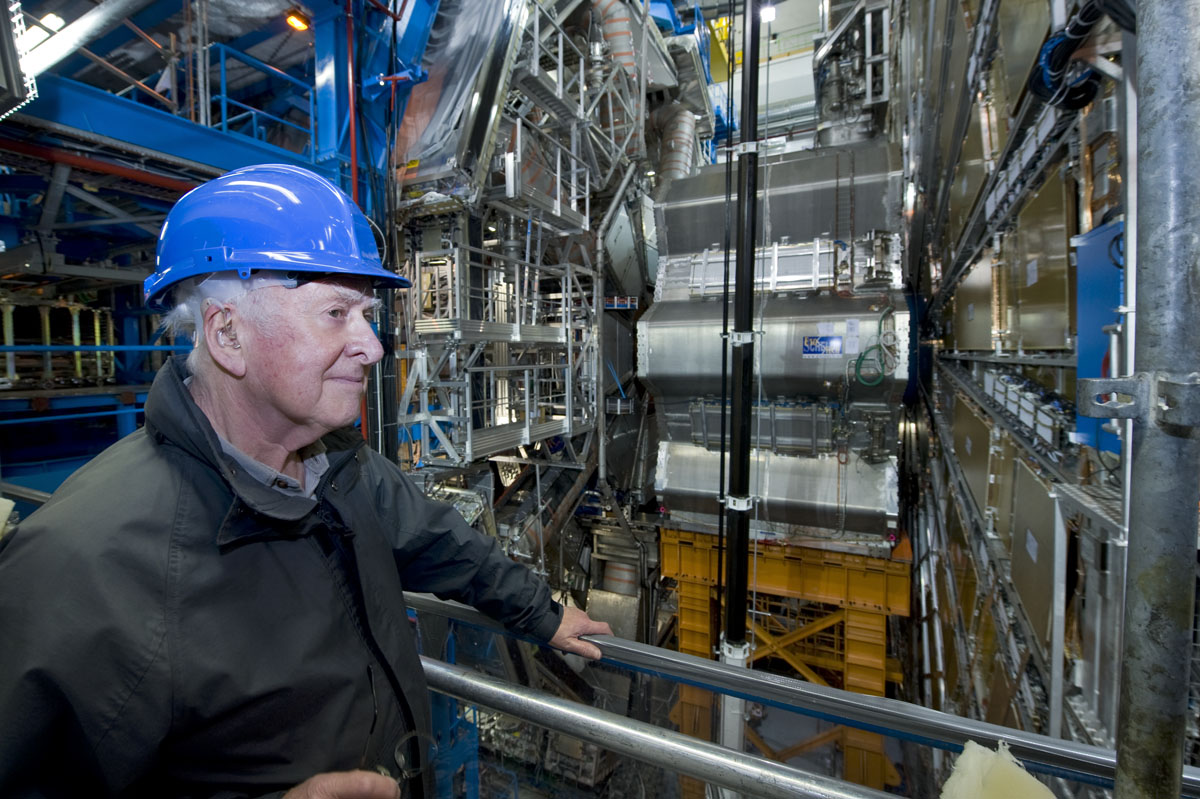 Peter Higgs in front of one of the ATLAS end cap toroidal magnets on his visit to the ATLAS cavern. Photograph copyright Claudia Marcelloni, ATLAS & CERN.