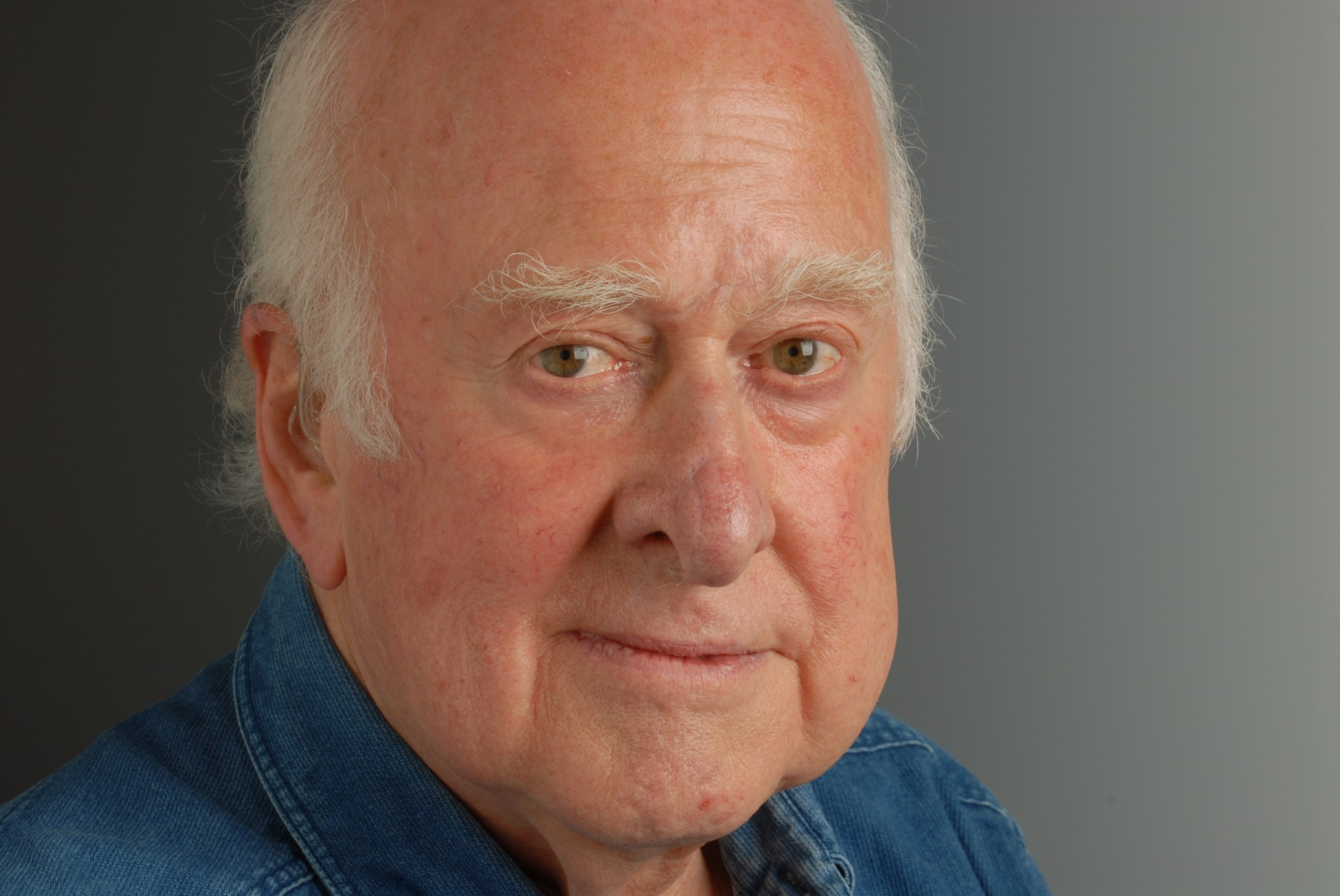 Close-up photographic portrait of Peter Higgs taken by Peter Tuffy. 17 June 2009.