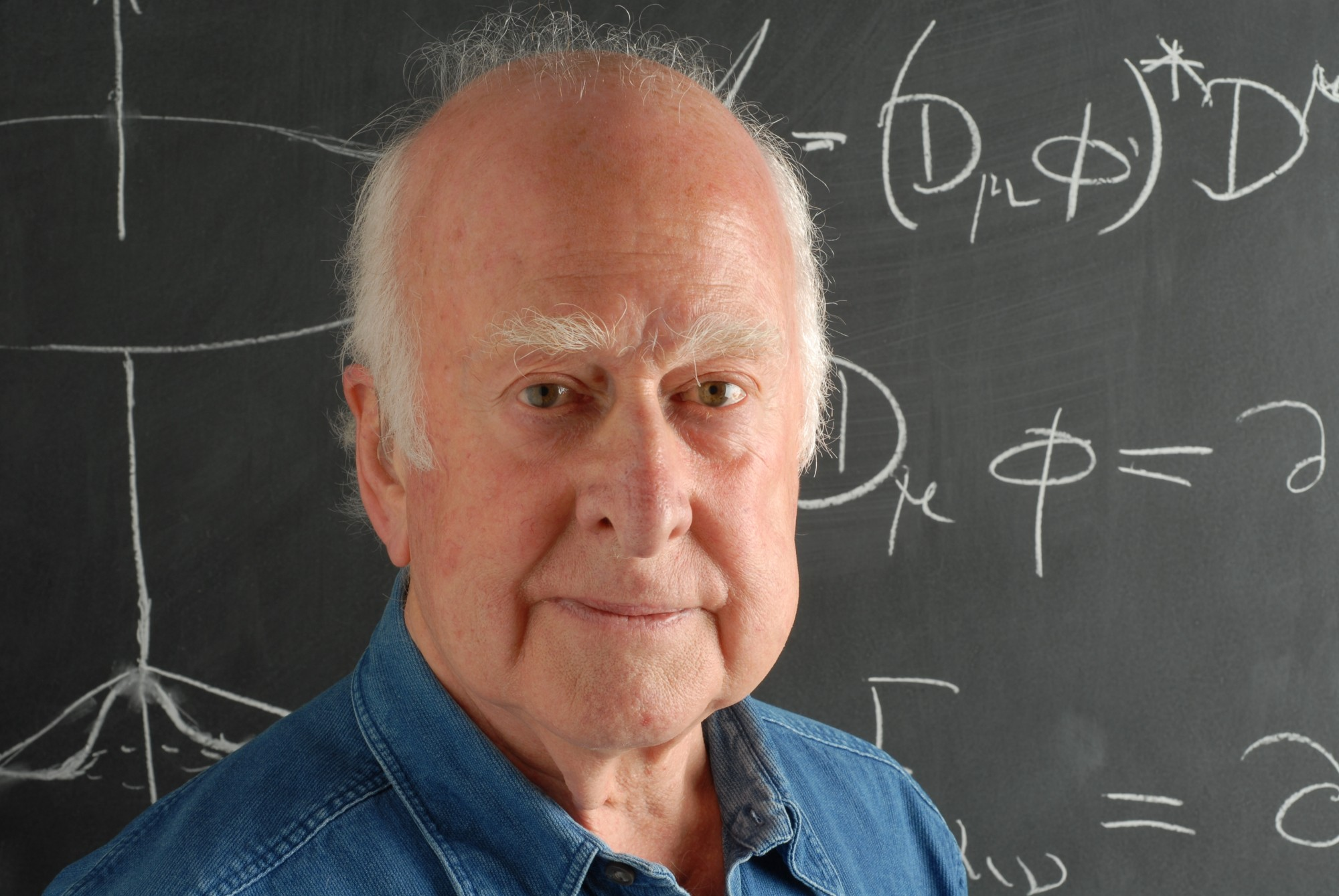 Close-up photographic portrait of Peter Higgs, in front of blackboard, taken by Peter Tuffy. 17 June 2009.