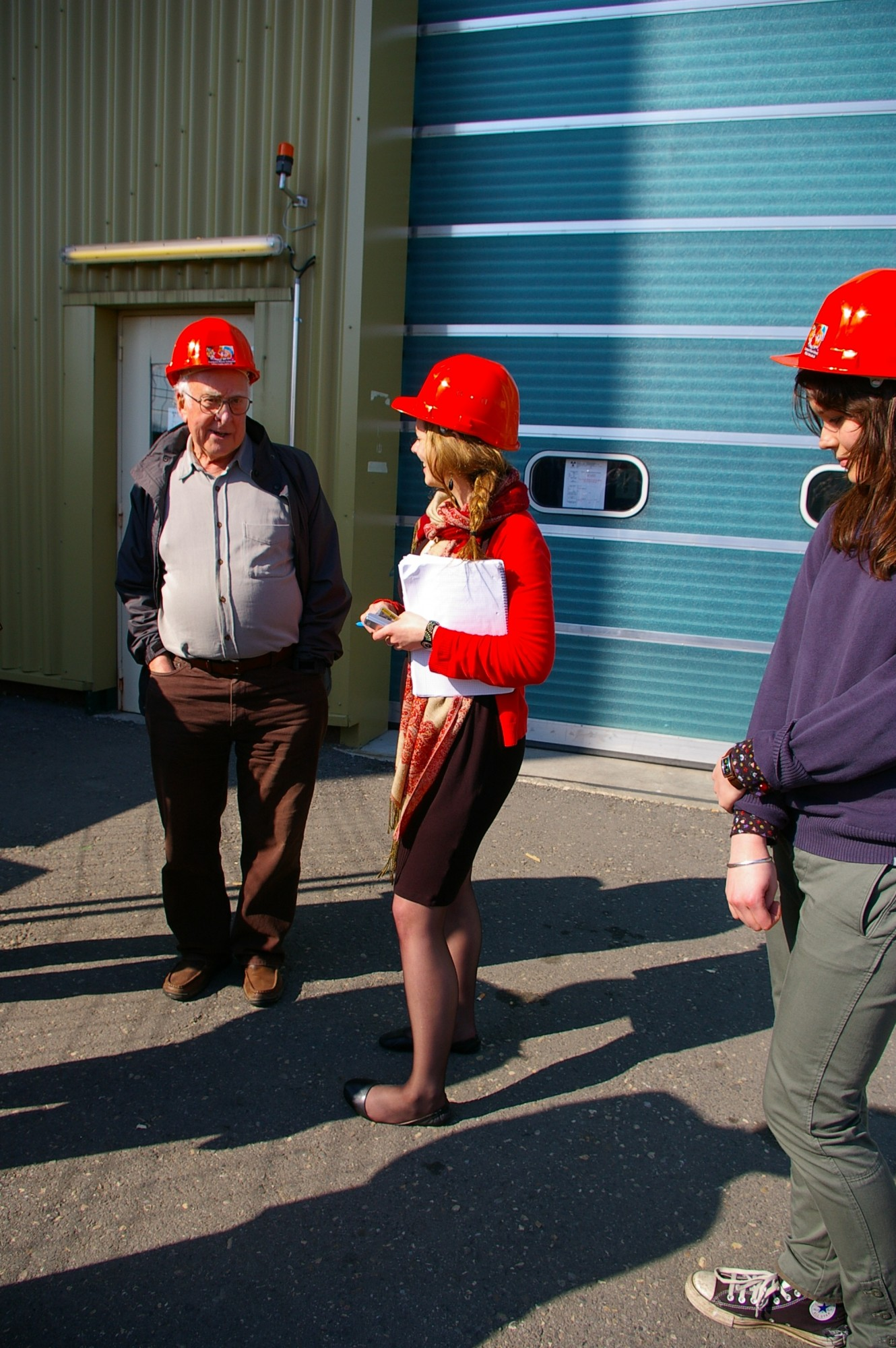 Peter Higgs, Elizabeth Gibney of the CMS collaboration and Jessica Griggs talking after the visit to the CMS construction hall and underground experiment hall. Photograph copyright Alan Walker, University of Edinburgh.