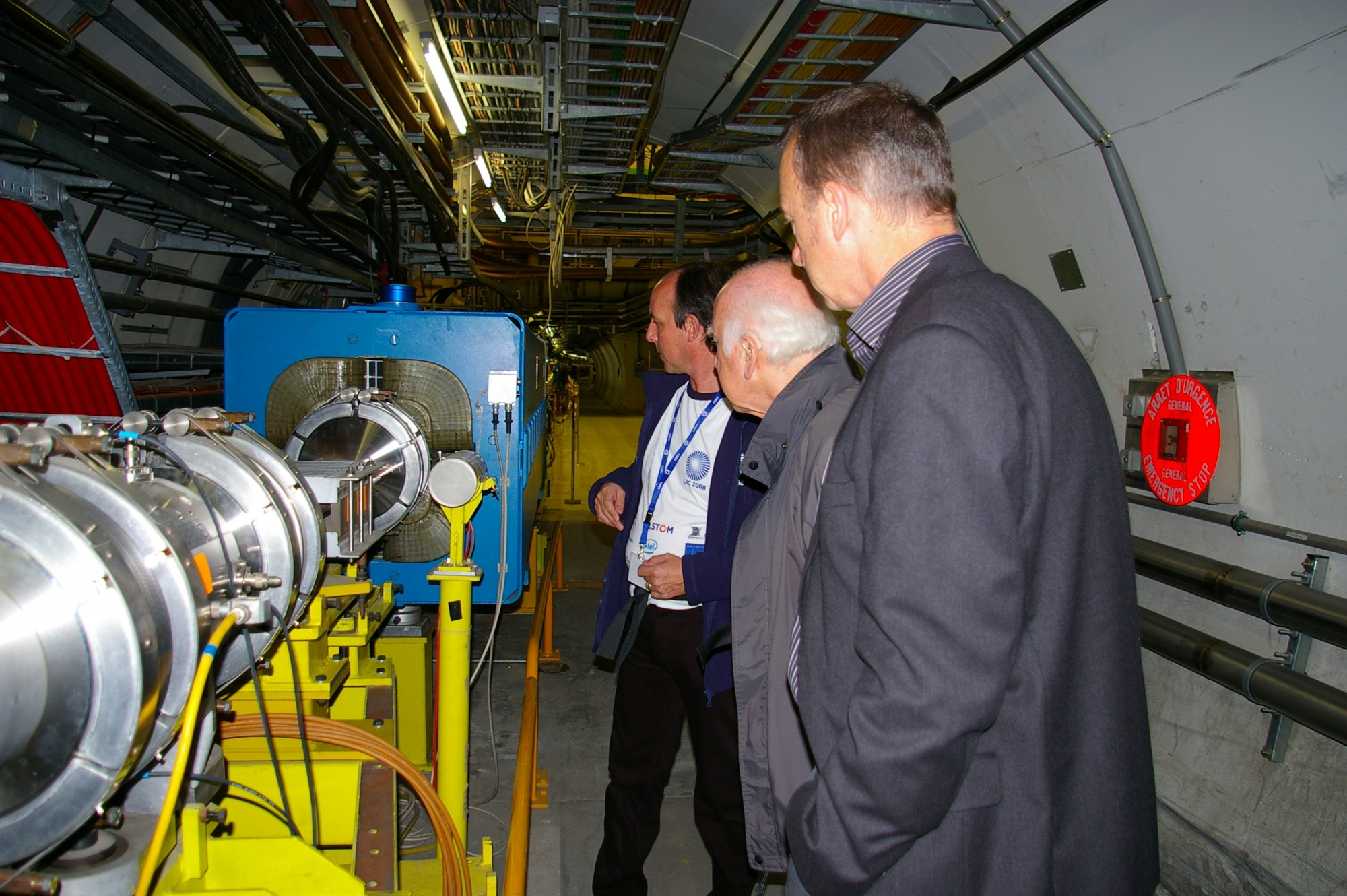 Richard Kenway and Peter Higgs during the visit to the SPS tunnel and the site of the UA1 experiment. Photograph copyright Alan Walker, University of Edinburgh.