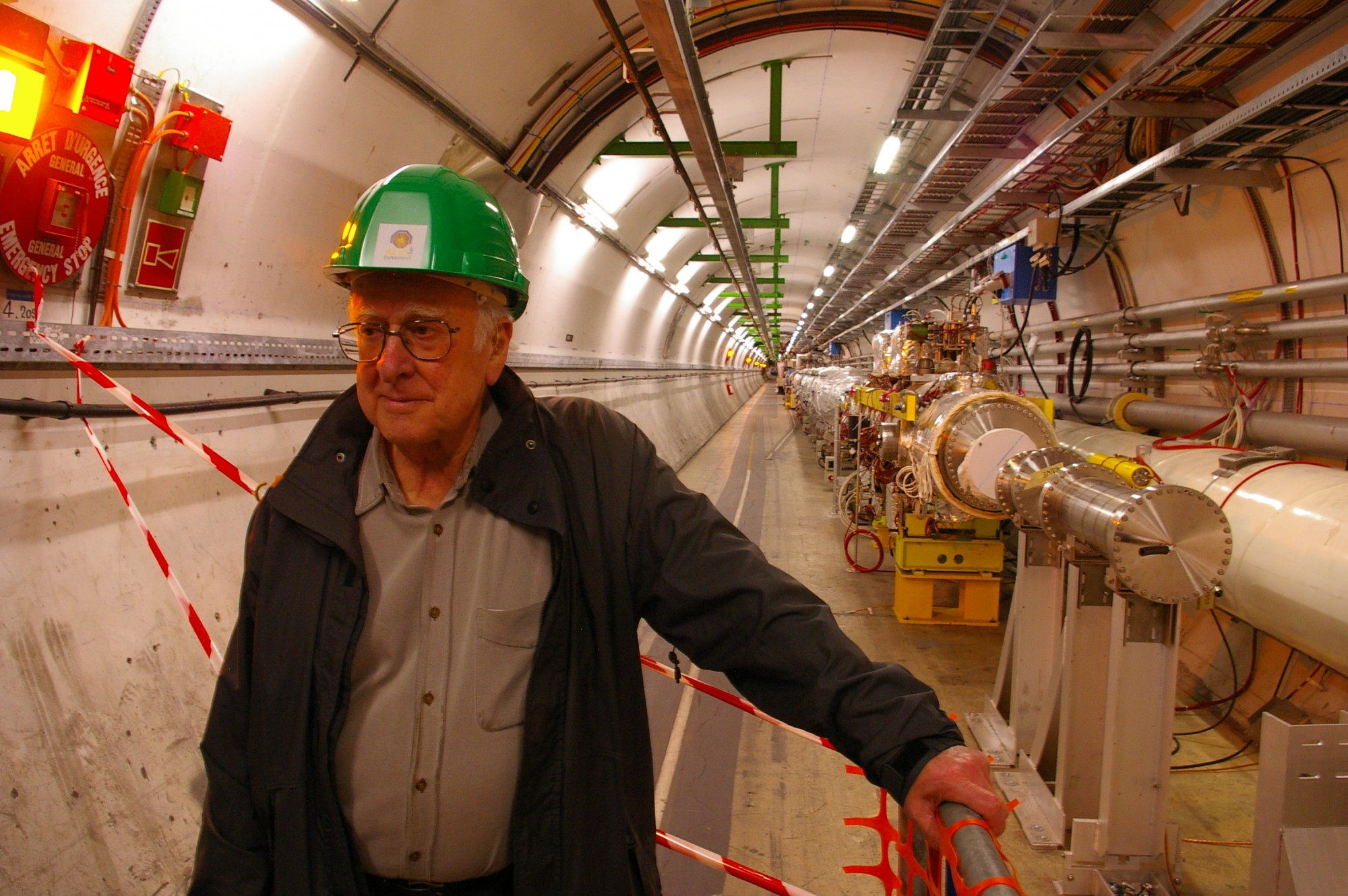 Peter Higgs in the long straight section of the Large Hadron Collider tunnel, just before the underground ALICE experimental hall. Pic: Alan Walker, University of Edinburgh.