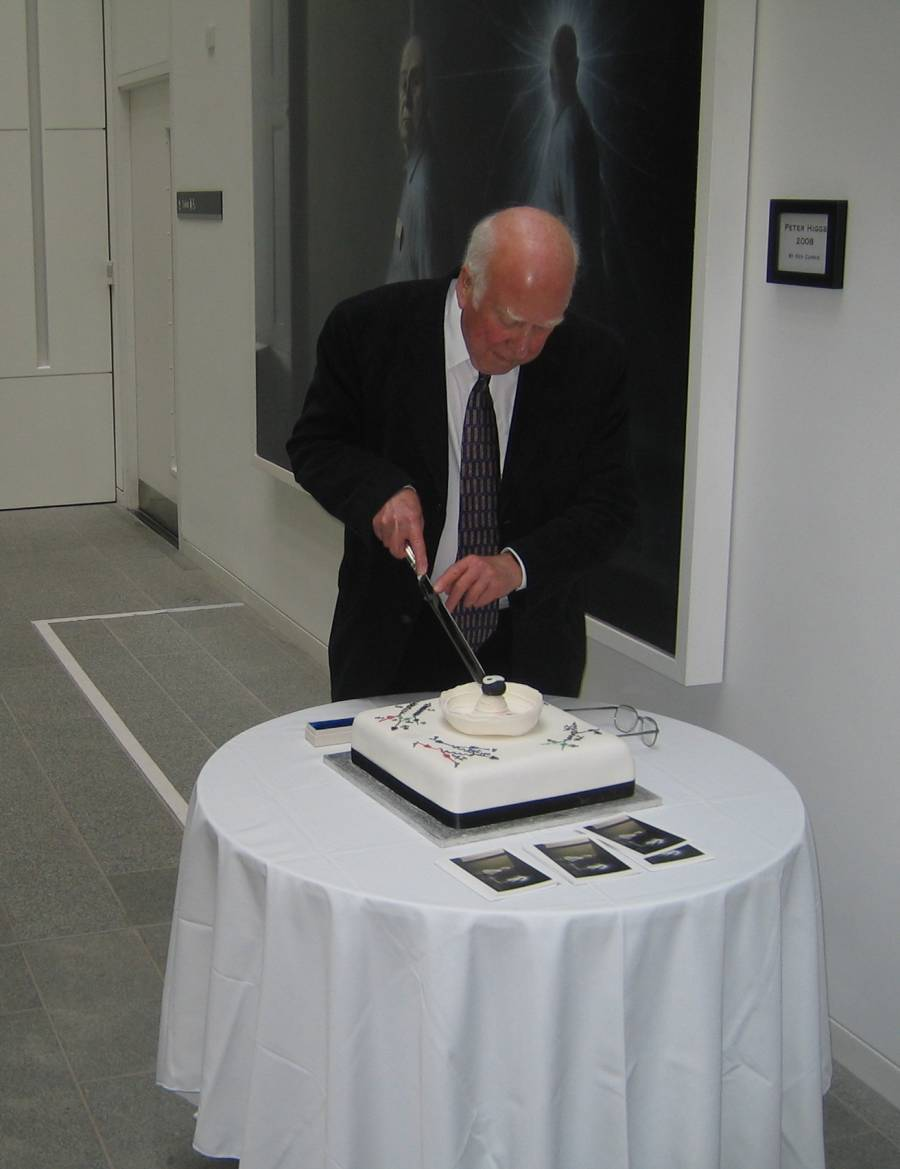 Peter Higgs cutting his 80th birthday cake.