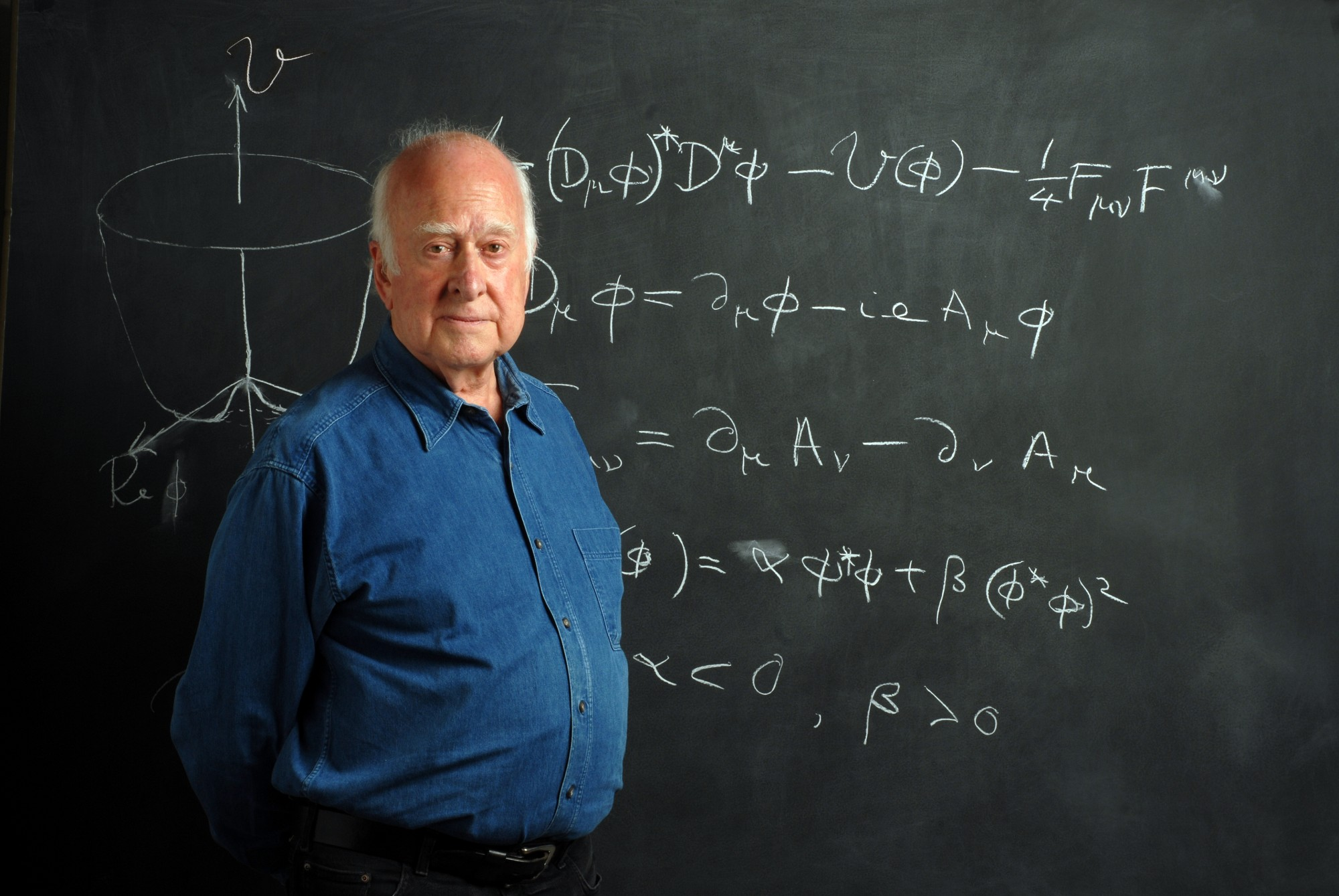 Photographic portrait of Peter Higgs, in front of blackboard, taken by Peter Tuffy. 17 June 2009.