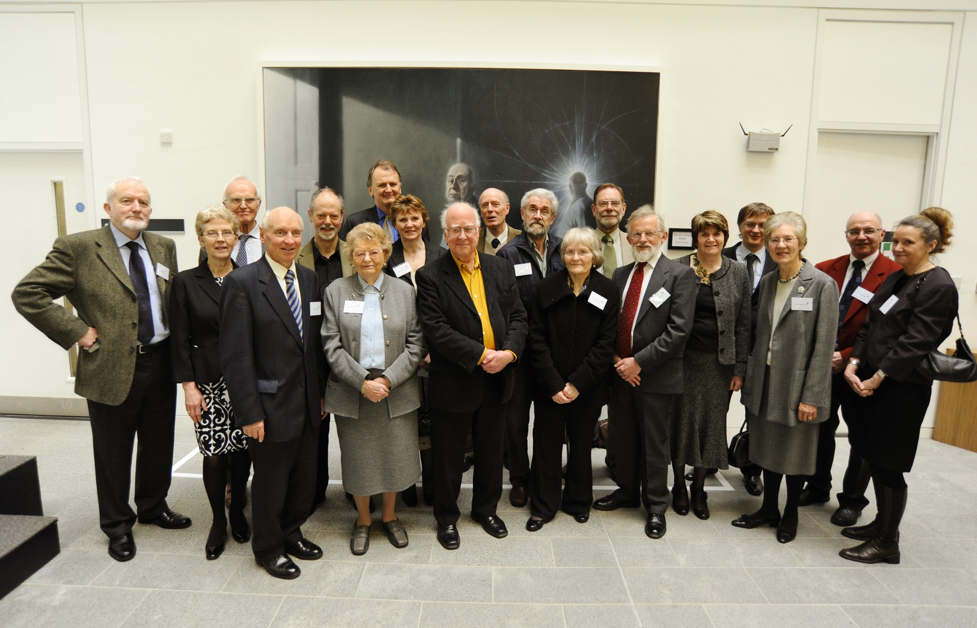 Peter Higgs pictured with former members of the Taiit Institute of Mathematical Physics and their partners.