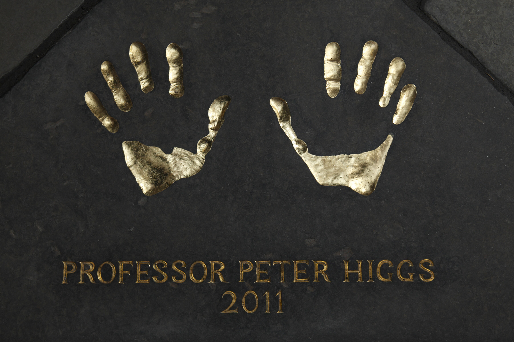 Copied from impression made in clay, Peter's hand prints were sculpted into a slab of Caithness stone which was relaid in the quadrangle of the City of Edinburgh City Chambers.