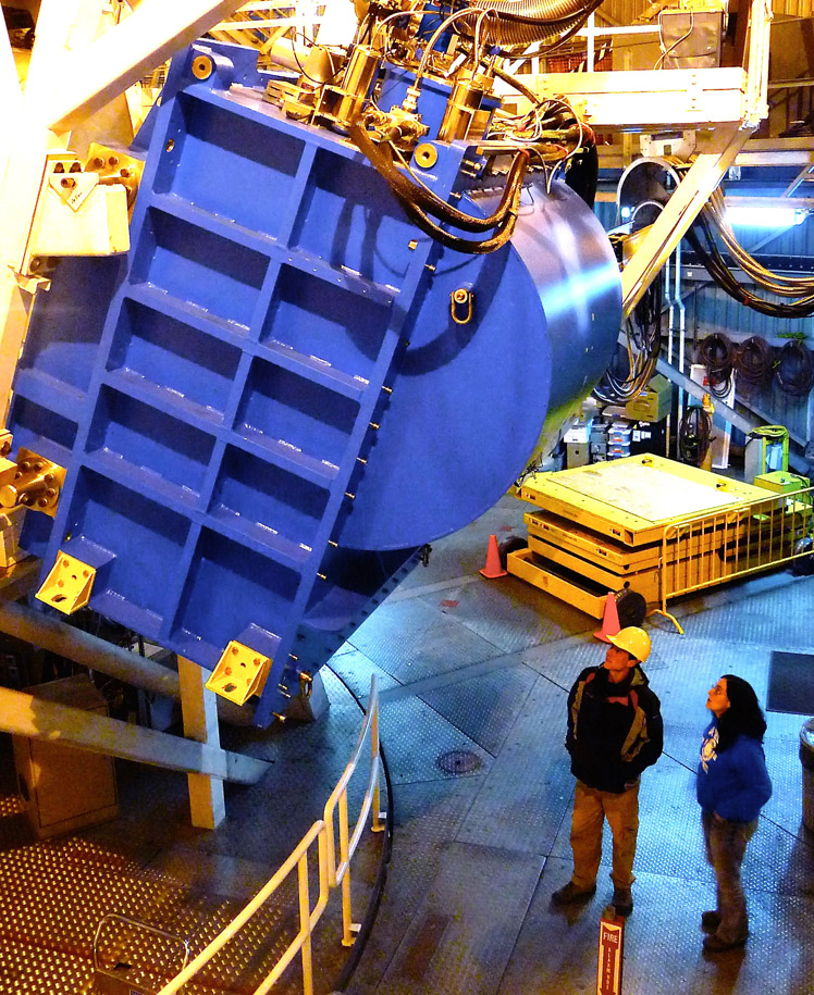 The instrument weighs 4.5 tonnes and is 3 m high. The massive blue box contains the camera and keeps it cold at only 0.1 degrees C above absolute zero (-273 degrees C). Submillimetre light from the telescope enters through a small window on the left-hand side (behind the white bars) and is directed onto the two sets of detectors. Credit: Joint Astronomy Centre