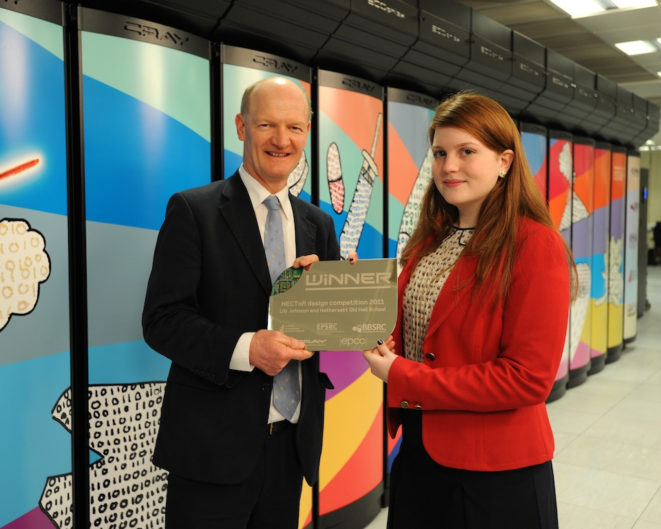 David Willetts, Minister of State for Universities & Science, presents a plaque to Lily Johnson to commemorate her success in the HECToR art competition.
