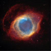 The Helix Nebula: a star at the end of its life. The star has blown off its outer layers, which show up in a nebula. These outer layers are rich in stardust grains of the sort that we find in meteorites in our Solar System.