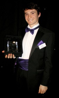 Robert Concannon with his award for Best Postgraduate Who Tutors